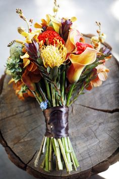 beautiful flower bouquet that's not made of roses. really like the color combi of dark but vivid yellow with purple and red accents **     This beautiful bouquet would be perfect for a fall bride.