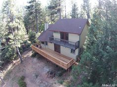 6784 Log Cabin Ln, Placerville, CA 95667 — Move in ready! Fabulous view of Slab Creek Reservoir on the American River, and trees as far as the eye can see! Large covered porch welcomes your guests, large new rear deck to enjoy the spectacular mountain setting! Three bedrooms, 2 full baths, great room concept, detached 2 car garage on 2.5 private acres. Freshly painted interior. Clear pest & septic and it appraised at $267,000!