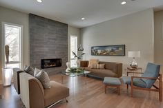 A Rambler Interior Design Living Room, It looks clean with the textures &' tile flooring looks smooth with traditional furnishing Houzz Interior Design, Modern Interior Design, Interior Design Living Room, Fireplace Surrounds, Fireplace Design, Condo Design, House Design, Reno, Cozy Living Rooms