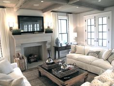 like the cream sofas facing each other, 2 decorative, comfy chairs on end facing fireplace