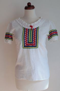 https://www.etsy.com/listing/274898078/vintage-peasant-blouse-1970s-embroidered?ref=shop_home_active_5