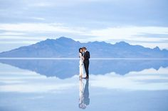 Floating Bride and groom..Reflection on salt lake in Utah...Beautifully Surreal Wedding Photos Show Couple Walking on Water at Bonneville Salt Flats