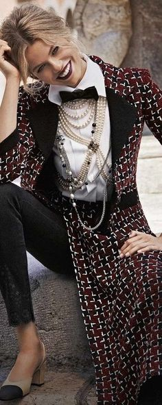Chanel is never tired of layering pearl jewelry. How many pearl necklaces is she wearing?!