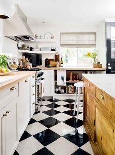 Fantastic kitchen inspiration for inexpensive remodels - VCT flooring and pre-fab cabinets made into a custom hutch