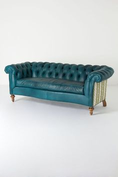 a chesterfield sofa in teal leather with striped upholstered sides and back.Milo Sofa from Anthropologie Funky Furniture, Unique Furniture, Sofa Furniture, Furniture Design, My Living Room, Living Spaces, Interior Exterior, Interior Design, Take A Seat