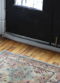 Blue Striped Door Draft Stopper -One of the simplest ones on this list this blue and white draft stopper exudes an old-world charm that I never tire of ... & Insulating Door Draught Excluder | I like this | Pinterest | Door ...