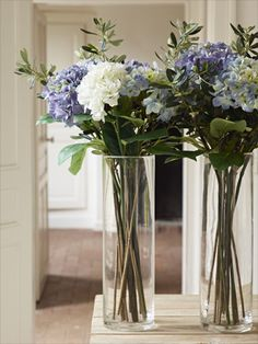 beautiful with all white flowers and evergreen in the clear vases I have