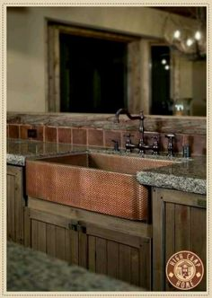 I like this combination of metals, from the hammered copper sink, to the faucet choice, to the square tiling, and the raw edged granite with unfinished wood... looks really well done.