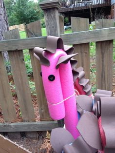Pool noodle stick horses using craft foam, twine, button eyes & hot glue. Turned out great; kids loved them!