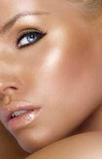 Dewy cheeks - contour, strobe, blush, shimmery neutral shadow on lids. Black khol on top lid, slightly winged out. Brown liner on lower lash line. Mascara. Nude lipgloss.
