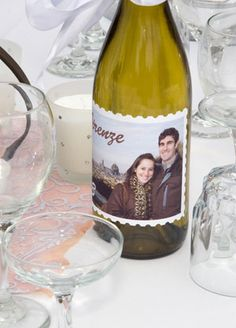 If you liked yesterday's wine charms, today we have come across a new twist for making your own wine labels.  Create this stamp or vintage look wine label to personalize your tables. Use as a centerpiece or as your table number display. Pick a few of your favorite photos. print on sticker paper and stick on the wine bottles.Materails Needed:- Photos of you and your sweetie- Sticker Labels (OfficeMax.com or Staples.com - about $14 for 30)- A pair of Pattern Edge Sissors (any craft