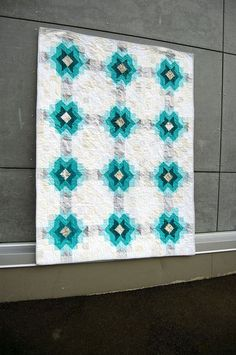 A subtle-but-striking quilt from Blair.  I love the neutrals paired with teals and turquoise in this star design.