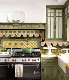 arts and crafts kitchen - tiles may be over the top, but gotta love 'em