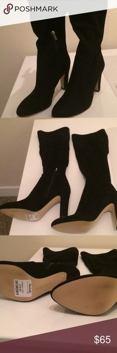 Black Knee High Boots Never worn! Two zips - one on ankle and one in the back to help get on. Zippers are gold. These come to the bottom of my knee and I'm 5'4. Heel height is 3.9. Bought at Marshalls for $80 a few years ago. Black fabric is suede like but not actual suede. Ivanka Trump Shoes Heeled Boots