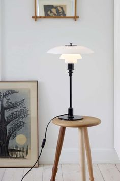LOUIS POULSEN PH 3 1/2 LAMP Along with most of the Louis Poulsen PH collection, the 3 1/2 table lamp is a classic of Danish design that is as timeless as it is ubiquitous. It may be the perfect desk lamp, thanks to the shades that offer targeted light that's not hard on the eyes.