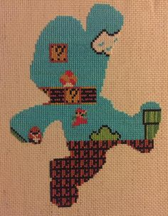 Apparently, it's more Mario! Reddit user down_the_hatch stitched up this awesome silhouette for a Mario-obsessed nephew. UPDATE: It was brought to my attention that the person selling the pattern f...