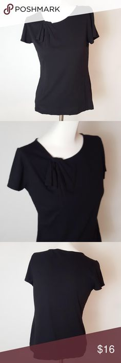 "Banana Republic Tee Banana Republic Tee. Cute neck detail - fabric folds through a hole to create gather at neckline. Size Medium. Color: black. 55% cotton, 45% modal. Measurements: 34"" bust, 22 1/2"" length. Banana Republic Tops Tees - Short Sleeve"