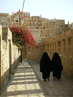 """A stroll in Sana'a, Yemen.  The Hijab these women are wearing refer to any head, face or body covering worn by Muslim women that conforms to a certain standard of modesty. It not only refers to the physical body covering, but also embodies a metaphysical dimension, where al-hijab refers to """"the veil which separates man or the world from God""""."""
