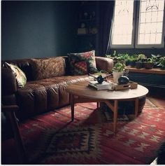 Kim's beautiful dark living room: walls and ceiling in Farrow & Ball's Down Pipe and Plummett, leather sofa and kilim rugs... Sigh !