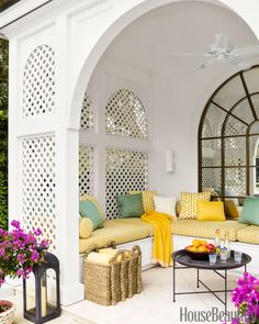 """In a Naples, Florida, house, the poolhouse, with cushions in Pollack's Shoreline fabric, """"was a cavern before we installed the mirror,"""" designer Jesse Carrier says. """"Now it reflects the light and is so inviting."""""""