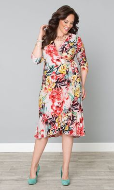 Feel as beautiful as a sunset on a tropical island in our Flirty Flounce Wrap Dress. Gorgeous coral hues blend attractively with hints of yellow and jade for a refreshing print.