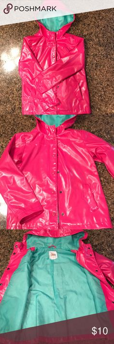 Girls Pink Hooded Lightweight Raincoat Girls size M (7-8) Pink Hooded Raincoat. This Raincoat is Pink on the outside & Teal on the inside. The tag says Medium but it looks like a size (7-8). I tried it on my daughter who's that size & it fits nicely with some room. It has button closure & in the back it has a nice crease for a pretty look at the bottom. This is a very pretty lightweight Raincoat! 😊 Jackets & Coats Raincoats