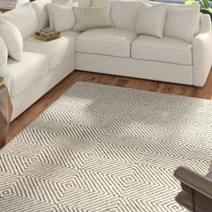 Take any floor space from dull to dazzling with this Marcelo Hand-Tufted Wool/Cotton Ivory Area Rug. Crafted in India, it is hand-tufted of wool and cotton. Light Blue Area Rug, Orange Area Rug, White Area Rug, Beige Area Rugs, Patterned Carpet, Textured Carpet, Black Rug, Black White, Beautiful Living Rooms