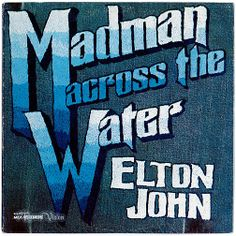 """""""Madman Across the Water"""" by  Elton John,  reached #8 in early 1972 on the Billboard 200, and was certified 2× platinum by 1998. The title song was set to be released on John's previous album """"Tumbleweed Connection"""" (it was re-recorded for this album). This was the first album in which Davey Johnstone played guitar for John, a role that would continue for decades to come. As with all John songs during this period, the lyrics were penned by his writing partner, Bernie Taupin. (Vinyl LP)"""