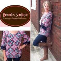 HURRY!! this GORGEOUS top is going quickly!! Get yours now! http://www.brandisboutiqueshop.co/item_1991/Pink-Navy-Mint-Design-Top-with-Crochet-Sleeves.htm.