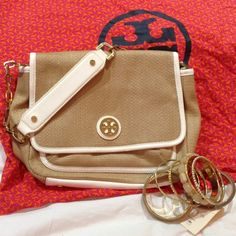 Tory Burch Burlap Shoulder Bag Good pre-loved condition. Tory Burch Burlap and White Leather Shoulder Bag. Minor signs of wear on handles and inside flap. No scratches or issues. Classy and sophisticated. Not in a rush to sell unless good reasonable offer is received. Comes with dust bag and bracelets shown. Tory Burch Bags Shoulder Bags