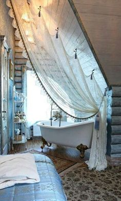 Rustic bedroom with bathtub in a private corner, facing a large window, with a lace curtain <3