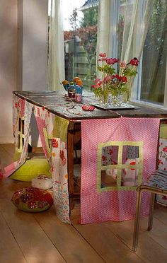 "I bought a ""low"" table for my son's room and had canvass panels sewn to hide storage under it.  I had  a few pockets sewn into it for art supplies/work table...but he would have loved this fort idea even more!"