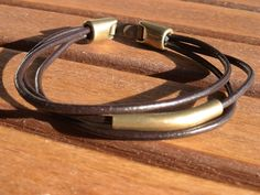 unisex brown mens leather bracelet with brass spacer. $23,00, via Etsy.