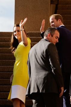 Prince William, Duke of Cambridge and Catherine, Duchess of Cambridge turn to acknowledge the crowd as they walk the stairs of the Sydney Opera House on April 16, 2014