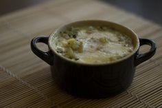 Cocottina con zucchine, patate, pinoli e toma