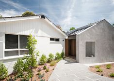 Inbetween Architecture's founder added this gabled extension to a suburban house in Melbourne, creating a new entrance that leads to a garden at the rear.
