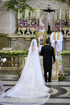 The Swedish royal bride Princess Madeleine turned to legendary couturier Valentino for her wedding gown, which featured silk organdies, ivory Chantilly lace and a four-metre train. 06/08/13.