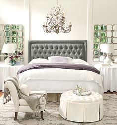 Hang a chandelier over the bed to create a focal point. ballard designs