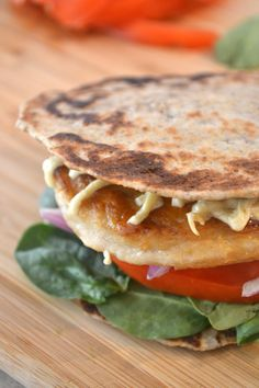 Gluten free Naan Bread used as a thintini burger bun (or sandwich bread or for dipping!). Forget the blander and more coarse gluten free flour taste and texture. This recipe makes a softer and chewier bread. All free, allergy free. The nutrient-conscious recipes in this site are egg free, dairy free, mustard free, peanut free, seafood free, sesame free, soy free, sulphite free, tree nut free and wheat free / gluten free.