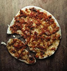 FLATBREAD WITH LAMB AND TOMATOES (LAHMACUN) Bake these Turkish spiced lamb and tomato flatbreads on a heated pizza stone in the oven so that the crust and topping cook evenly.