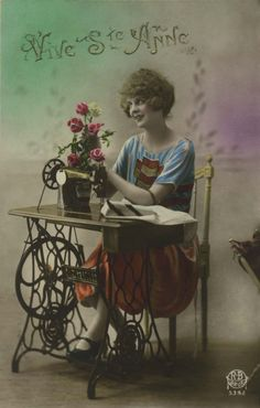 Vintage sewing postcard - lovely lady posing with Singer sewing machine (postmarked 1921).