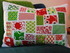 a mini ticker tape christmas pillow