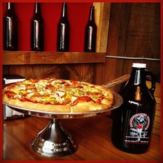 We belong together! #pizza + #beer = a perfect combo for a #saturday with #friends @barnstormerbeer #getoutandplay #visitbarrie #craftbeer #growler #400blondeale #yummy #barriedatenight
