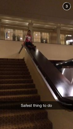 Kalani sliding down the side of some stairs