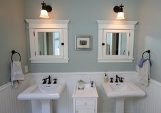 The master bathroom was finished with double pedestal sinks and mirrored medicine cabinets.