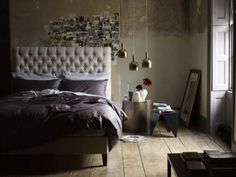 Dan would like the headboard in brown leather and do a den like style in the room.