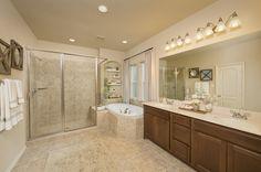 Amazing Bathrooms - 2,344 Sq. Ft. - Master Bathroom - #PerryHomes #trustedbuilder #realestate #townhomes #duplexes #homebuilding #homebuilder #homebuying #HoustonHomes #SanAntonioHomes #AustinHomes #openconcept #openfloorplan #classicdesign #interiordesign #homedecor #bathroomdesign #bathdesign #masterbathroom #masterbath #gardentub #tilefloor #vanitylighting #bathroomvanities #walltile #mirrors #showerheads #recessedlighting #amazingbathrooms #amazingbaths