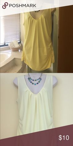 Yellow drape top size large Yellow drape top size large. Material: 95% Polyester and 5% Spandex Tops