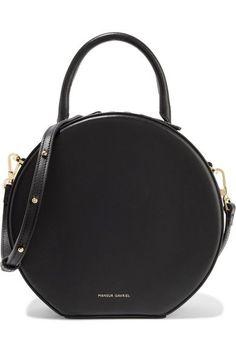 f53f27b565 The circular shape of @Mansur Gavriel s shoulder bag gives it a cool retro  fee
