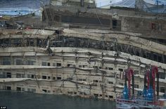 Costa Concordia upright   Costa Concordia: Cruise liner winched upright after lengthy £500m ...